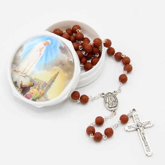 Rosary with rose petal